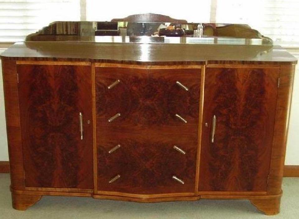 Flame mahogany art deco vintage sideboard. Click here to see more...