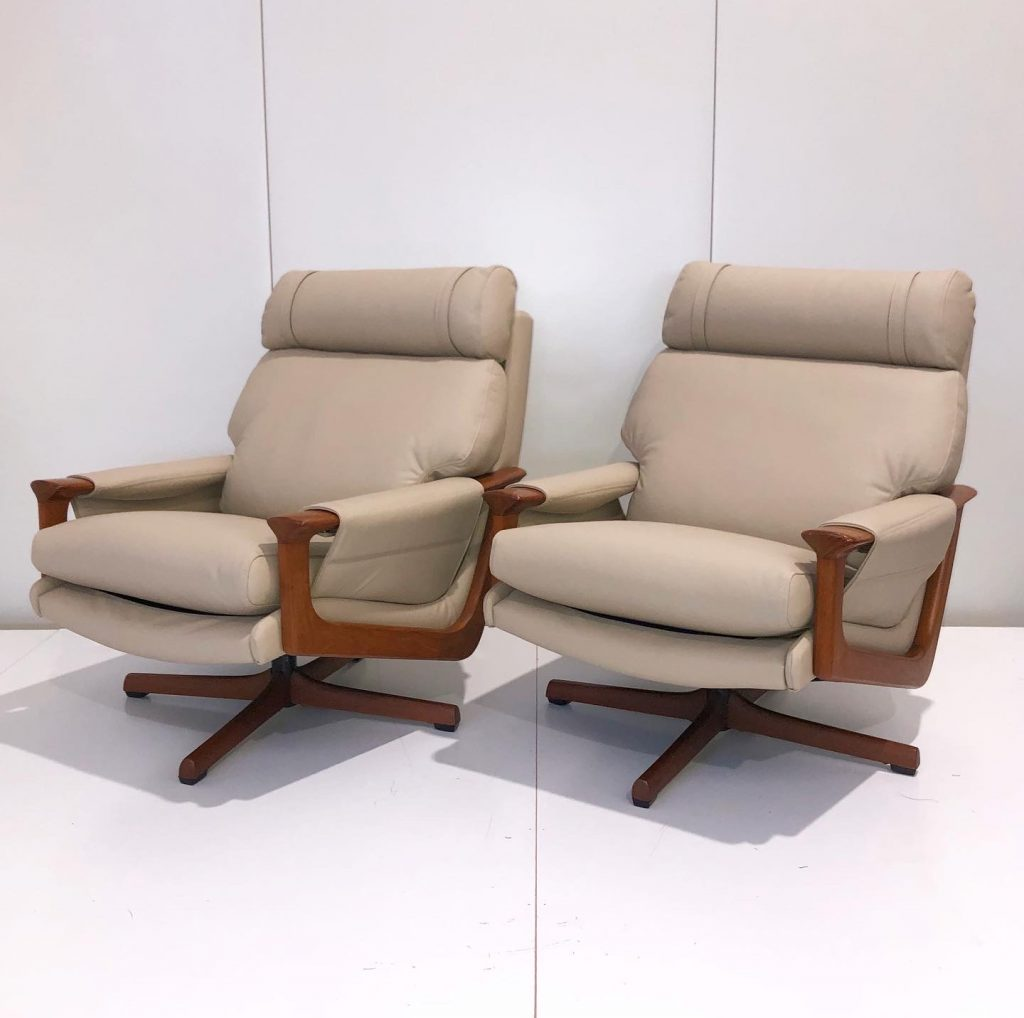 Recover two mid century Fler leather armchairs... see more